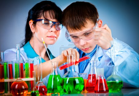 Photo for Schoolteacher and student working in the lab - Royalty Free Image