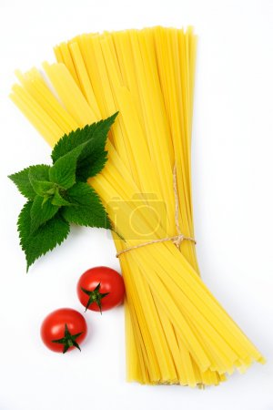Photo for An image of two red tomatoes and pasta - Royalty Free Image