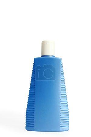 Photo pour Une image d'une bouteille bleue avec capuchon blanc - image libre de droit