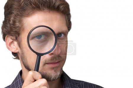 Photo pour Homme avec une loupe - image libre de droit