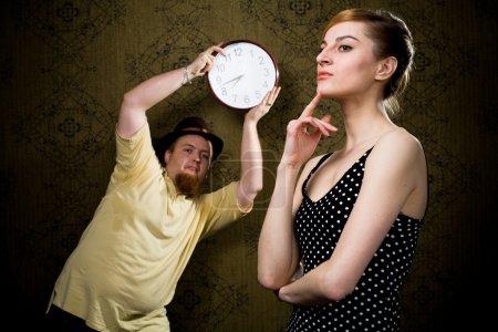 Foto de Una imagen de un hombre con un reloj y una buena mujer - Imagen libre de derechos