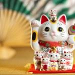 Maneki Neko cat. Common Japanese sculpture bring g...