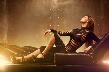 Young sexy woman lying on sofa....