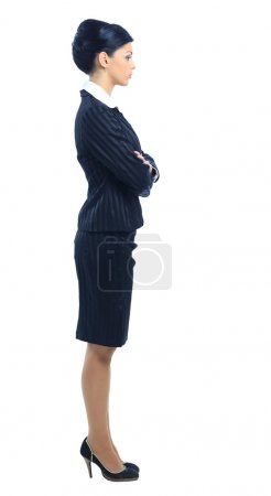 Full length, side view of a confident young business woman standing with fo