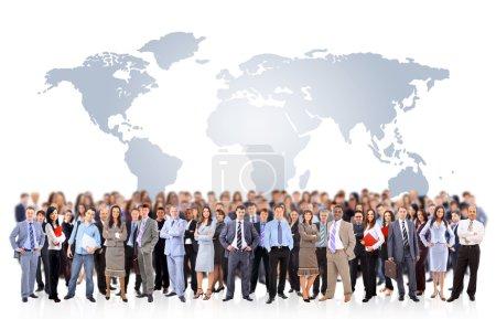 Foto de Equipo de negocios con el mapa de mundo - Imagen libre de derechos