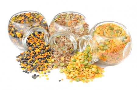 Glass Jars with Assorted Cereals (Lentils, Rice, Split Peas) Isolated on W