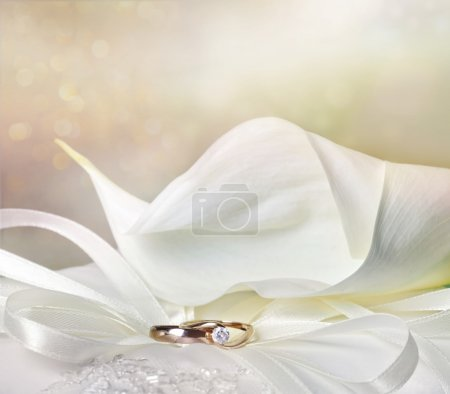 Photo for Wedding background with calla lilies and golden rings - Royalty Free Image