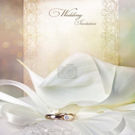 Photo for Wedding invitation card with calla lilies and golden rings - Royalty Free Image