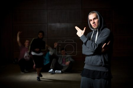 Young man and dancers