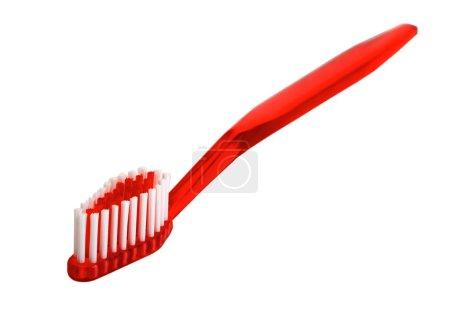 Photo pour Brosse à dents rouge isolée sur le fond - image libre de droit