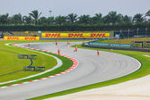 SEPANG, MALAYSIA - APRIL 9: Marshals clean track for qualificati
