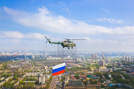 Photo for Helicopter with russian flag over Moscow at parade of victory day - aerial view - Royalty Free Image