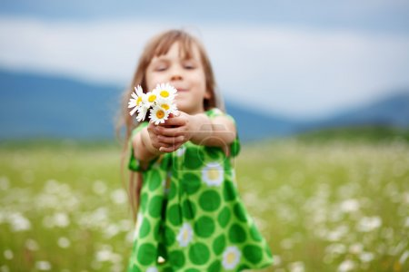 Photo for Cute child girl at camomile field - Royalty Free Image