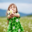 Cute child girl at camomile field...