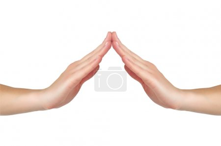 Female hands touch each other in form of a house or a roof