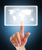 Female hand pushing virtual button with world map
