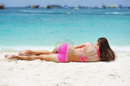 Photo for Girl laying on a tropical beach - Royalty Free Image