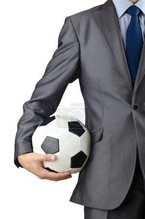 Photo pour Homme d'affaires tenant le football sur blanc - image libre de droit