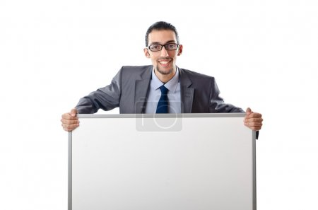 Young businessman with white board