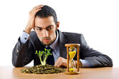 Businessman with gold seedlings and coins