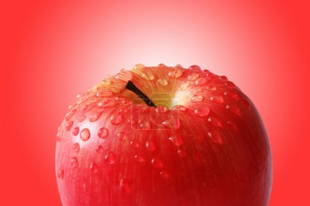 Fresh apple with water droplets