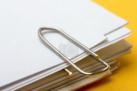 Photo for View of a paper clip with stack of blank paper - Royalty Free Image