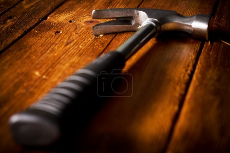 Photo for Hammer on wood board - Royalty Free Image