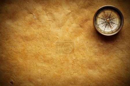 Photo for Close up view of the compass on old paper - Royalty Free Image