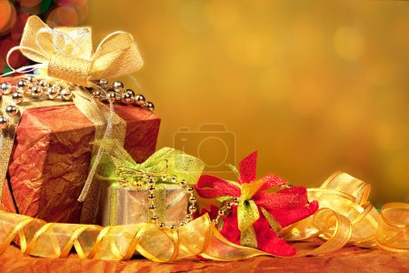 Red, Green, Gold, and Silver Wrapped Holiday Christmas Gifts