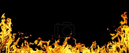 The close-up of yellow fire and dark as a backgroun