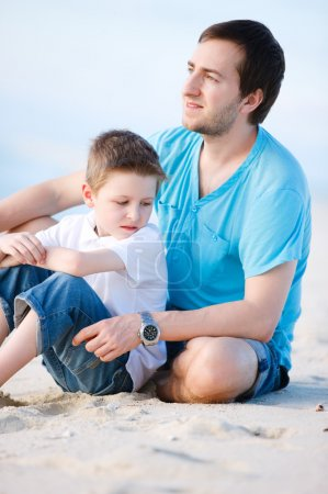 Photo for Outdoors portrait of happy father and son - Royalty Free Image
