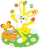 Velikonoční zajíček žongluje malovaná vajíčka