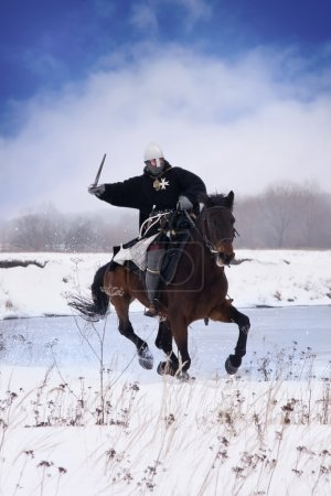 Medieval knight of St. John (Hospitallers) on a horse