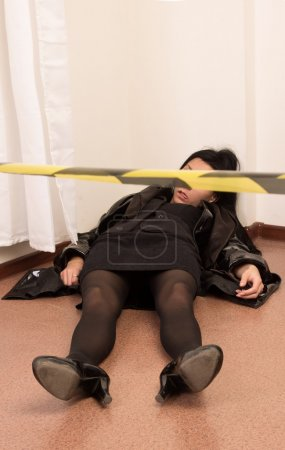 Killed victim lying on the floor (imitation)