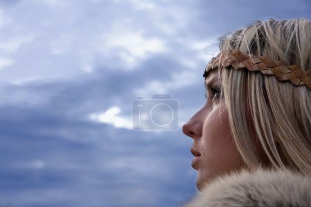 Viking girl on a dark sky background