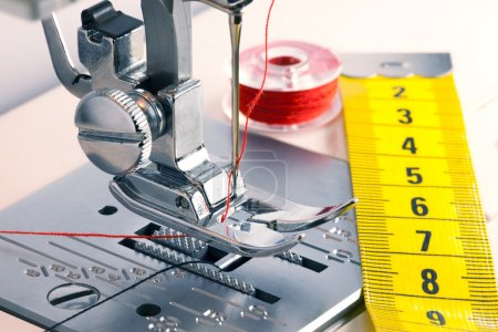 Photo for Detail of sewing machine and sewing accessories. - Royalty Free Image