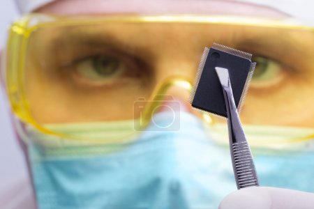Photo for Scientist examining a new microchip - Royalty Free Image