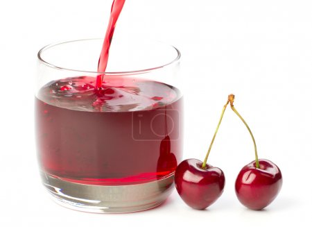 Cherries and a glass of cherry juice isolated on white
