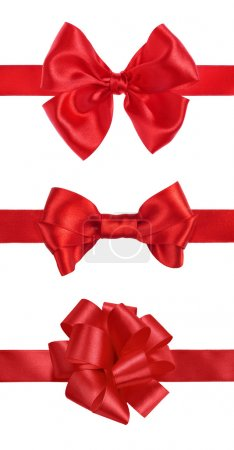 Red gift satin ribbon bows on white background
