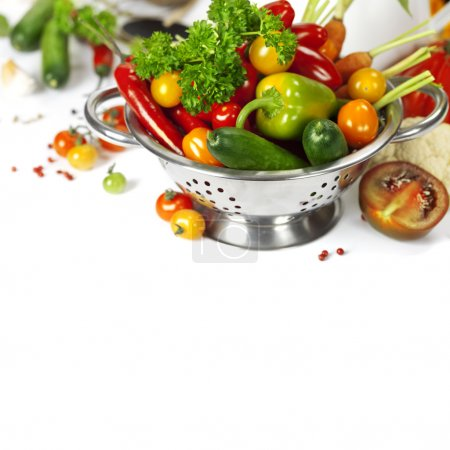 Photo for Fresh vegetables in metal colander over white - Royalty Free Image