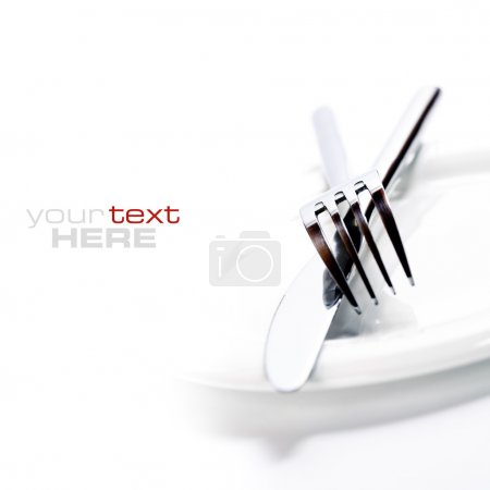Photo for Close up of a silver knife and fork on a white background (with sample text) - Royalty Free Image