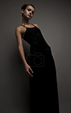 Photo for Beautiful woman on black classical dress pose in studio. Vogue style photo. - Royalty Free Image