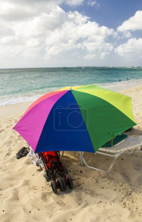 Sandy Beach with colorful Beach Umbrella