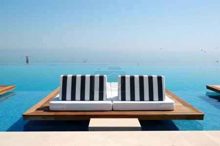 Photo for Infinity swimming pool by beach at the modern luxury hotel, Pieria, Greece - Royalty Free Image