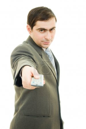 Businessman with a remote control on white background.