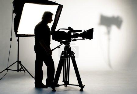 Photo pour Silhouette et caméras cameraman . - image libre de droit