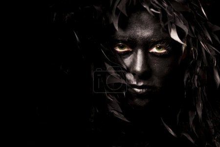 Photo for Close up portrait of evil spirit with green eyes, isolated on black - Royalty Free Image