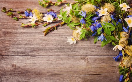 Spring flowers on woode background