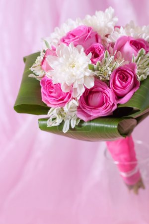 Wedding bouquet on pink background