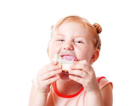 Girl eating cake. Isolated on white background...